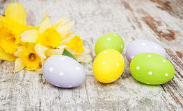 Easter eggs and daffodils Stock Images