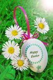 An Easter eggs with daisy on grass Stock Photography