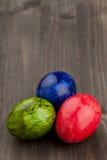 Easter eggs on dark table stock image