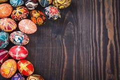 Easter eggs on dark wooden background. Stock Image