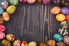 Easter eggs on dark wooden background. Royalty Free Stock Image