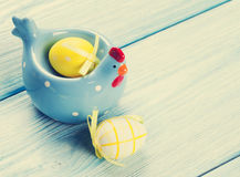 Easter eggs and decor on wooden table Royalty Free Stock Photo