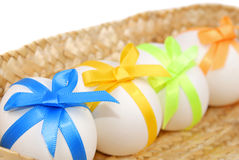 Easter eggs decorated with bows Stock Images