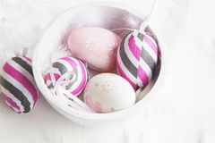 Easter eggs decorated with bows and feathers Stock Photo