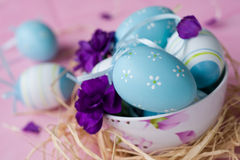Easter eggs decorated with carnations Royalty Free Stock Photo