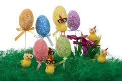 Easter eggs decorated with colorful dots. Small yellow chickens. Easter eggs decorated with colorful dots. Little yellow Chicks play in the grass royalty free stock photos
