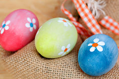 Easter eggs decorated with daisies and a sack Royalty Free Stock Photos