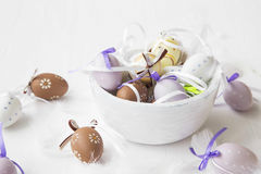 Easter eggs decorated and feathers Stock Image