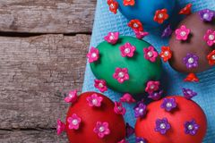 Easter eggs decorated with flowers on old table Stock Photos