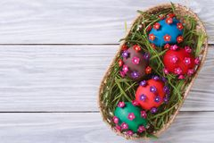 Easter eggs decorated with flowers top view Stock Photo