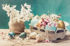 Easter eggs and spring flowers on rustic wooden background.Easter holiday card copy space. royalty free stock photography