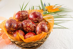 Easter eggs decorated with wax and a flower. Easter eggs decorated with wax and orange flower stock photography