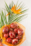 Easter eggs decorated with wax and a flower. Easter eggs decorated with wax and orange flower stock images