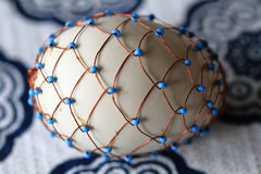 Easter eggs decorated with wire Stock Images