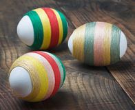 Easter eggs decorated with woolen threads Stock Image