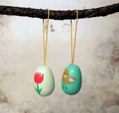 Easter eggs decoration for Easter branches. Two small easter eggs, hanging from a branch, decoration for Easter branches Royalty Free Stock Photography
