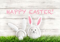 Easter eggs decoration Funny bunnies green grass Stock Image