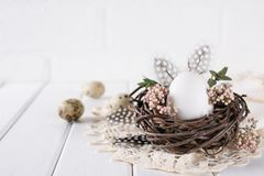 Easter eggs decoration. Nest with white chicken egg. Happy Easter greeting card Royalty Free Stock Photography
