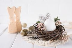 Easter eggs decoration. Nest with white chicken egg. Happy Easter greeting card Royalty Free Stock Photo