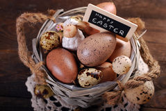 Easter eggs and decoration in old basket Stock Image