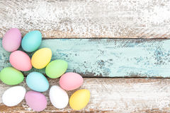 Easter eggs decoration rustic wooden background. Easter decoration. Pastel colored eggs on wooden background Stock Images