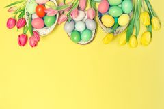 Easter eggs decoration tulip flowers vintage toned stock image