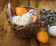 Easter eggs decoration in wicker basket Royalty Free Stock Image