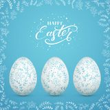 Easter eggs with decorative floral elements on blue background royalty free stock photography