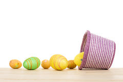 Easter eggs and decorative pink basket isolated. Royalty Free Stock Image