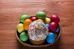 Easter eggs of different colors and cake Stock Images