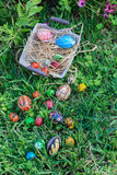 Easter eggs. Diverse Easter eggs in a basket, placed on a grass Stock Photography