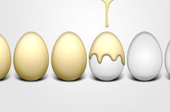 Golden eggs. Easter eggs and dripping golden paint Stock Images