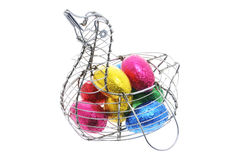 Easter Eggs in Duck-shaped Wire Basket Stock Images