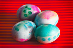 Easter eggs dyed, bright background. The egg, an ancient symbol of new life, has been associated with pagan festivals celebrating spring Stock Images