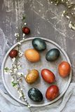 Easter eggs dyed with natural dyes, cabbage, chamomile, hibiscus and onion peel. Selective focus stock photos
