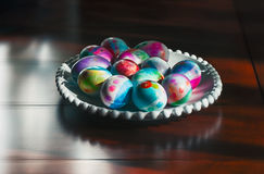 Easter eggs dyed, on a table. The egg, an ancient symbol of new life, has been associated with pagan festivals celebrating spring Royalty Free Stock Photo