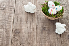 Easter eggs and easter bunnies. Basket with easter eggs and easter bunnies Royalty Free Stock Photos