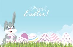 Easter eggs and easter bunny for decoration on fresh green grass Royalty Free Stock Photography
