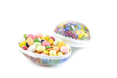 Easter eggs with Easter candy Stock Photo