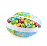 Easter eggs with Easter candy Stock Images