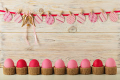 Easter eggs and Easter decor, paper eggs with a pink ribbon on a Stock Images