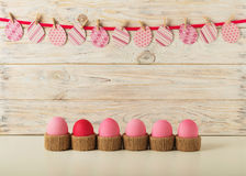 Easter eggs and Easter decor, paper eggs with a pink ribbon on a Royalty Free Stock Images
