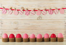 Easter eggs and Easter decor, paper eggs with a pink ribbon on a Stock Image