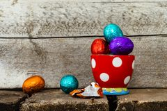 Easter eggs in egg cup royalty free stock photos