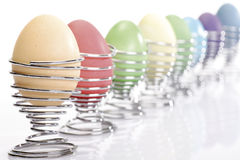 Easter eggs in egg cups Stock Photos