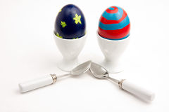 Easter Eggs in Egg Cups with Spoons Stock Photography