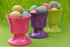 Easter eggs in eggcups Stock Photos