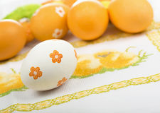 Easter eggs on the embroidered cloth Stock Image