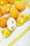 Easter eggs on the embroidered cloth Stock Photography