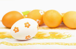 Easter eggs on the embroidered cloth Royalty Free Stock Photography